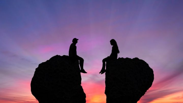 image of a couple on two separate rocks with a sunset in the background. image is being used to represent the idea that after you complete your collaborative divorce with ogborne law, phoenix based family lawyer, your ex will find a new partner and you'll need to deal with it.
