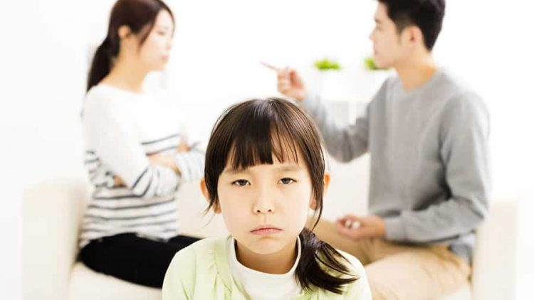 man and a woman arguing with their daughter sitting nearby looking upset. this image is being used to convey that even if you've had a collaborative divorce that sometimes things can still fall apart and you need to contact ogborne law firm, phoenix family law firm, to help you work it through.
