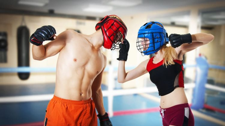 image of a man and a woman in a boxing ring fighting. image illustrates a couple fighting and the importance of fighting properly to save your relationship and if things don't work out to work with ogborne law, phoenix collaborative divorce attorney